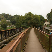 Foot and railway bridge over the river that runs through the valley