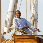 Abdulhamdy at the tiller, steering us down the Nile in Egypt
