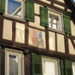 Heraldic painting and faded charm